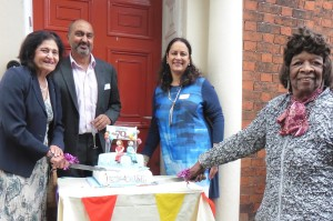 Mrs Usha Khosla, Dr Dinesh Phakkey, Dr Sarbjit Phakkey and Madge Tillsley cut the Dentist @Redhouse 70th anniversary cake